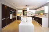 Kitchen with white bench tops