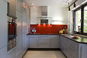 Kitchen with red splash back