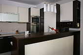 Brown dark coloured kitchen