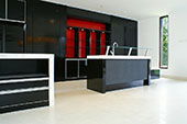 Black kitchen with CeaserStone benchtop